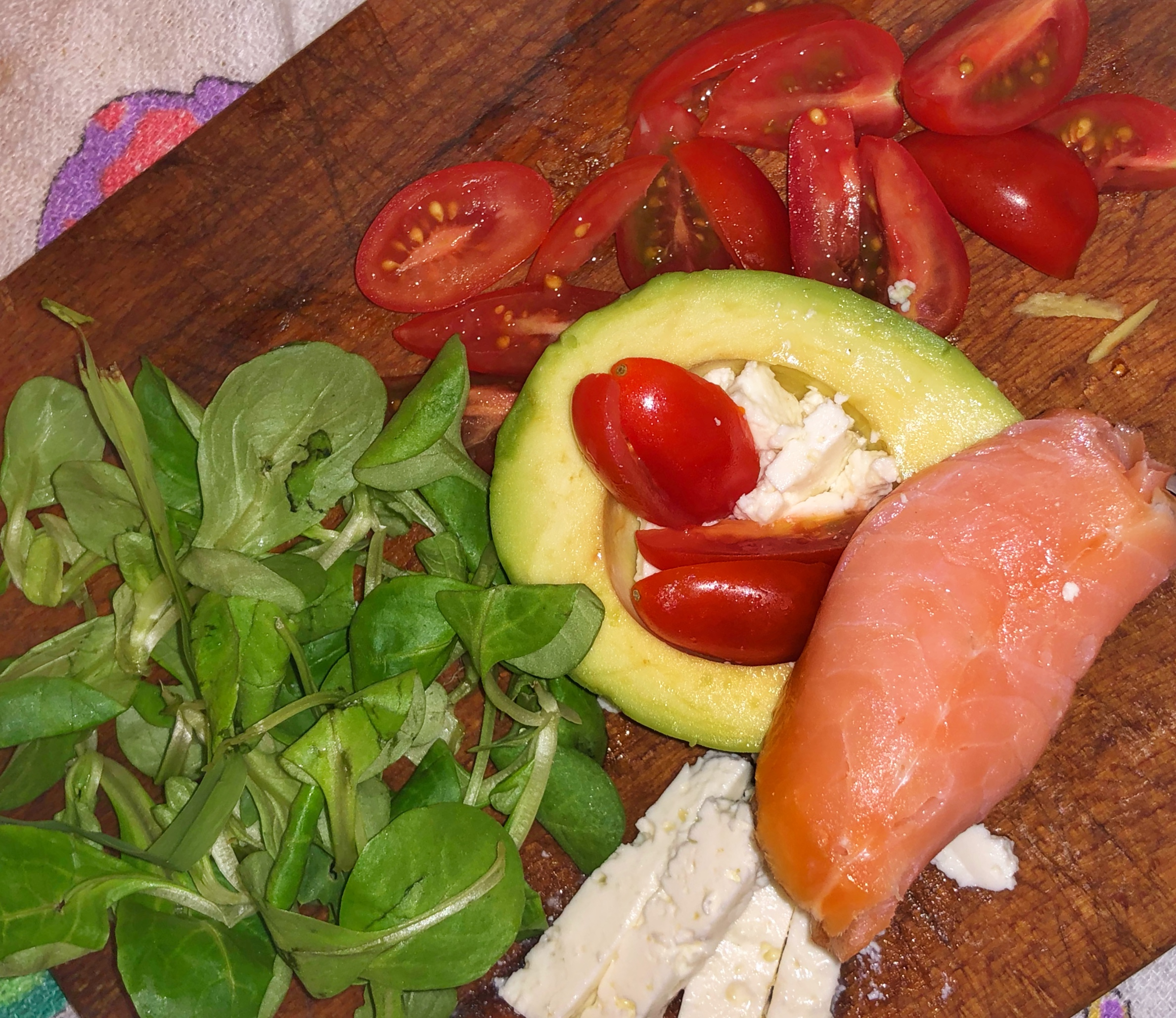 Salmon, Avocado, Cherry Tomatoes and a bit of Rapunzel Salad for a healthy meal